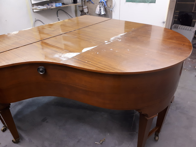 Bunhag grand piano before repolishing Mahogany satin.