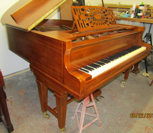 Bunhag grand piano sideview.