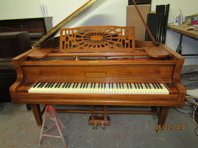 Bunhag mahogany grand piano.