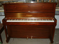 Chappell reconditioned & repolished upright piano.