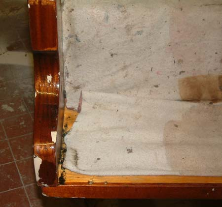 Repaired damage to piano cheek