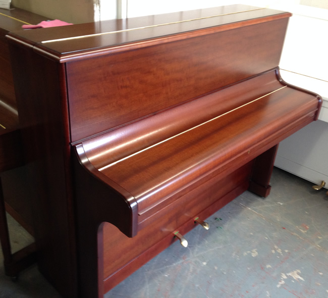 August Forster Traditional upright Repolished in a Satin Mahogany finish.