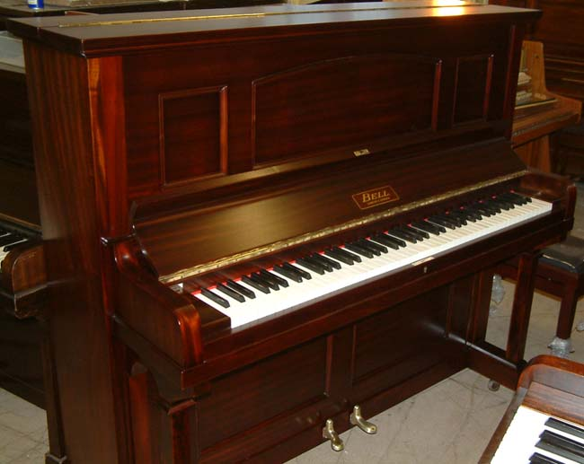Bell Traditional upright piano repolished in a Dark Mahogany satin finish.