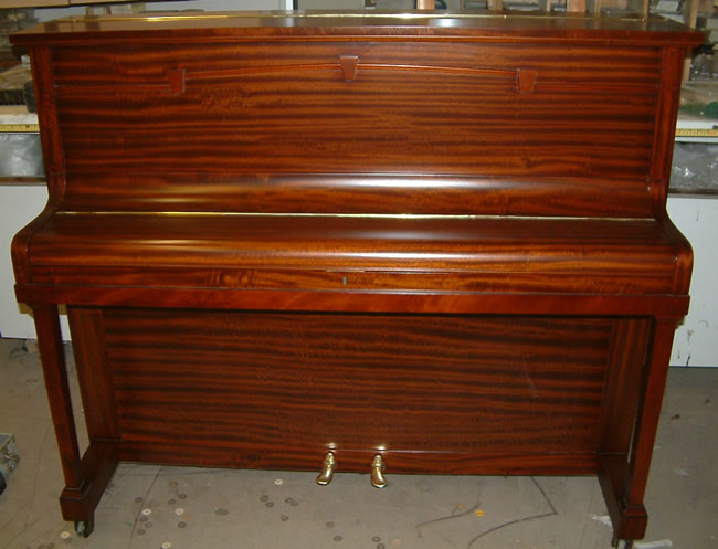 Chappell Traditional Upright piano repolished in a Satin Mahogany finish.