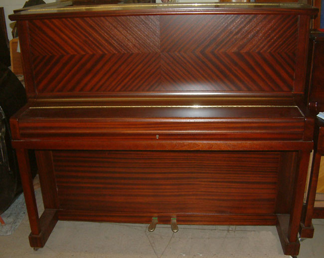 Reisbach Traditional upright piano repolished in a Mahogany satin finish.
