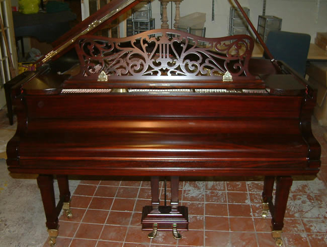 Chappell baby grand repolished in a rosewood satin cabinet.