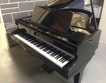 Challen 6ft grand piano repolished in a Black high gloss cabinet.