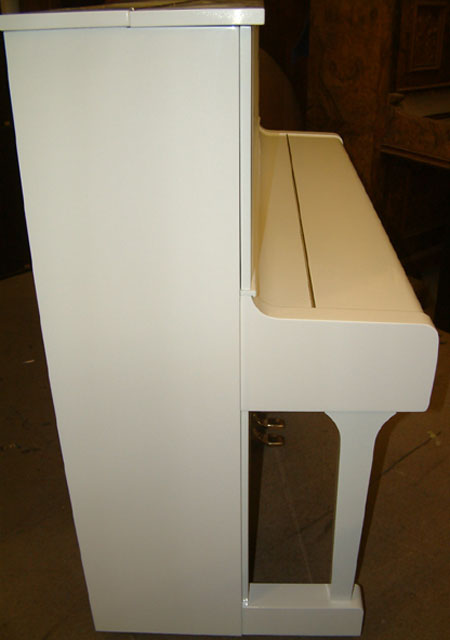 White Yamaha Piano in a High Gloss Finish