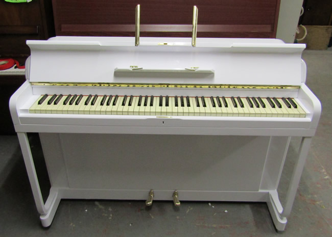 Kemble Minx small modern piano in a White gloss wrapped finish.