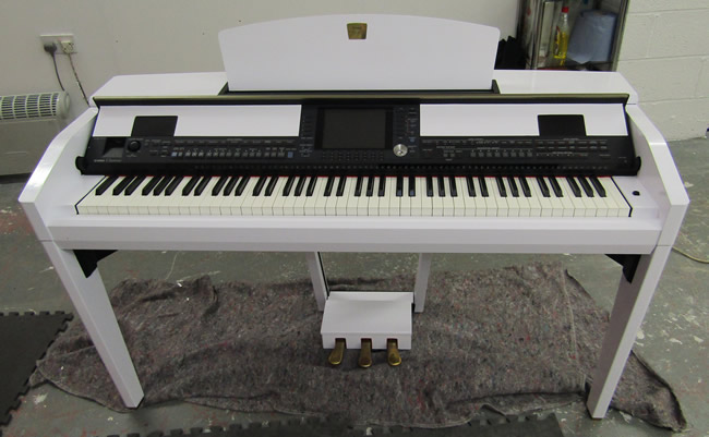 Yamaha digital piano wrapped in white gloss.