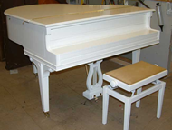Baby grand pianos repolished in various colours and sheens.