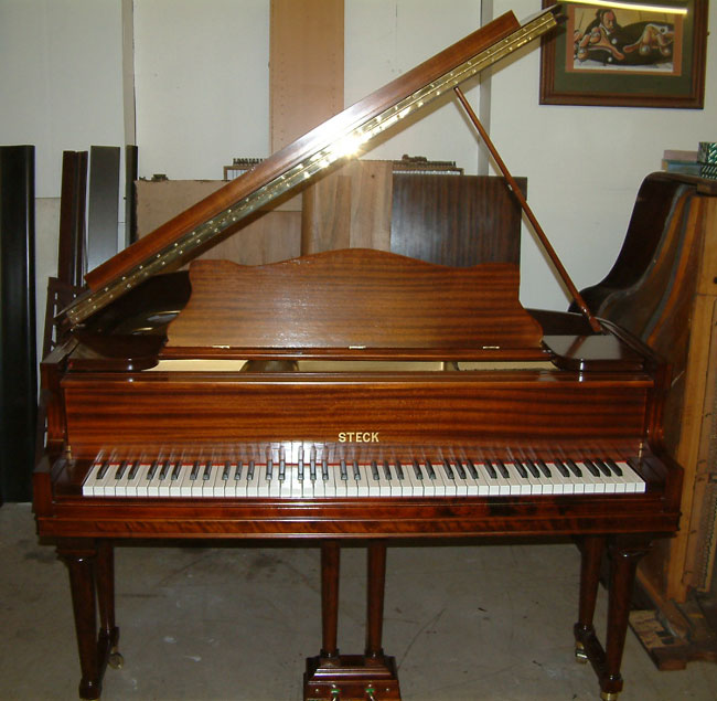 Steck baby grand in a Mahogany satin finish.