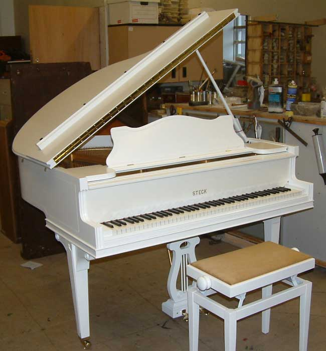 Steck Art Case baby grand piano in a White Satin finish.